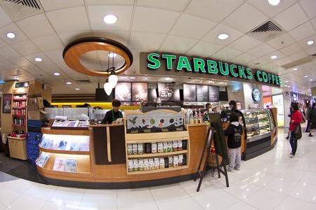 starbucks: HONG KONG - JAN 6, Starbucks Coffee in Hong Kong on 6 January, 2012. It is a worldwide shop.