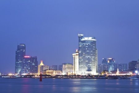 Xiamen downtown at night along the coast photo