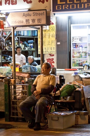 HONG KONG - FEB 16, A Chinese hawker in Apliu Street, Hong Kong on 16 February, 2012. It is one of the feature in old Hong Kong.