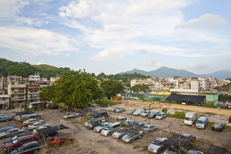Car park and village in countryside of Hong Kong