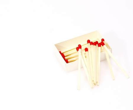 pyromaniac: Red matches isolated on white background