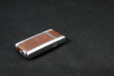 Fire lighter on black background Stock Photo - 12685375