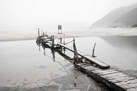 desolation: Desolated pier next to the sea