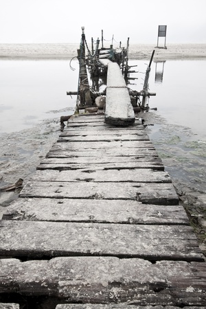 Desolated wooden pier in low saturation photo