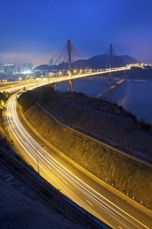 Ting Kau Bridge at night along the highway in Hong Kong photo