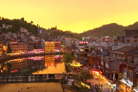 Fenghuang ancient town in Hunan Province at sunset time Stock Photo - 12716536