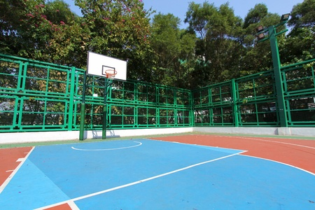 Basketball court in sunny day Editorial