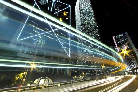 Traffic through downtown of Hong Kong at night Stock Photo - 12717413