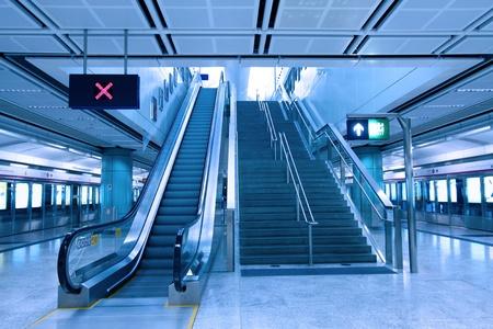 Moving escalator in train station