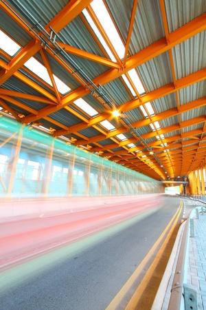 Orange tunnel traffic at day Stock Photo - 13193448