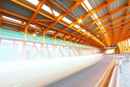 Orange tunnel traffic at day photo