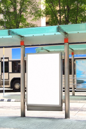 Blank billboard on bus stop photo