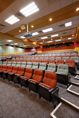 lecture theatre: Lecture hall with colorful chairs in university