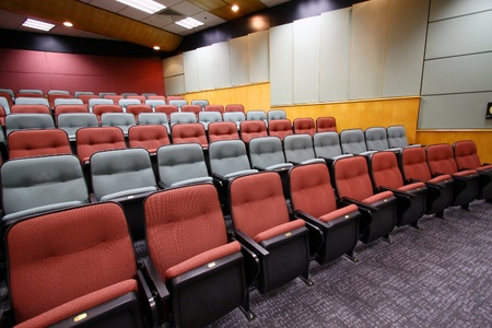 theater seat: Lecture hall with colorful chairs in university