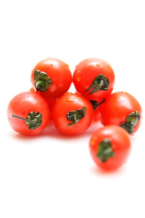 Cherry tomatoes isolated on white background photo