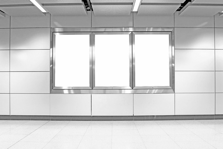 Blank billboard in train station, mono tone.