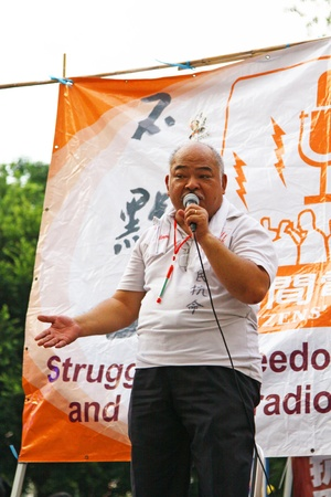 massacre: HONG KONG - JUN 4, Tsang Kin-shing at Victoria Park to ask for donation for the expenditure of Citizens Radio before the commeoration of the 22nd aniversary of the Tiananmen massacre at 4 June, 2011 in Hong Kong.