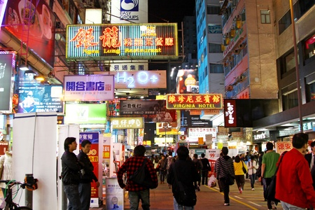 HONG KONG - JAN 27, The busiest street, the Sai Yeung Choi Street South with many people walking through in Hong Kong on 27 Januray, 2011. There are many different brands set up their shops here.  Stock Photo - 12716796