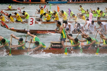 HONG KONG - JUN 16, Dragon boat race in Tung Ng Festival in Tuen Mun, Hong Kong on 16 June, 2010. It is a traditional festival in Chinese community. Stock Photo - 12935874