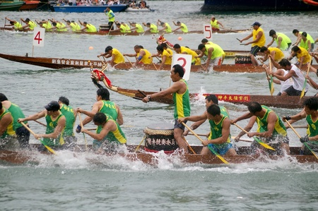 HONG KONG - JUN 16, Dragon boat race in Tung Ng Festival in Tuen Mun, Hong Kong on 16 June, 2010. It is a traditional festival in Chinese community. Stock Photo - 12935860