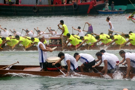 HONG KONG - JUN 16, Dragon boat race in Tung Ng Festival in Tuen Mun, Hong Kong on 16 June, 2010. It is a traditional festival in Chinese community. Stock Photo - 12935815