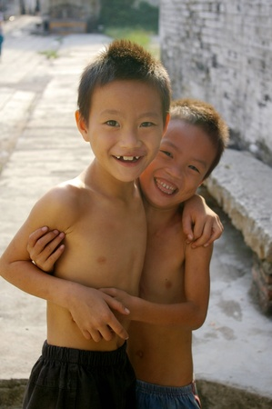 CHINA - OCT 11, Two young Chinese boys smiling in a village in Zhongshan, China on 11 October, 2009.