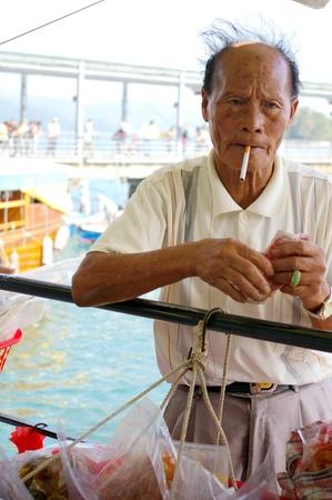 HONG KONG - NOV 17, A Chinese fisherman is selling his fishes in Sai Kung, Hong Kong on 17 November, 2009.  Stock Photo - 12935763