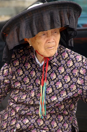 hing: HONG KONG - FEB 22, A Hakka old woman in Kat Hing Wai of Hong Kong on 22 Feburary, 2009. They speak the Cantonese dialect Weitou dialect, rather than Hakka.