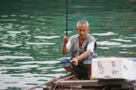 HONG KONG - NOV 29, An old fisherman in Hong Kong on 29 November, 2009.  Stock Photo - 12935887