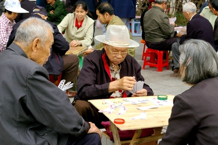CHINA - MAY 15, Many old people are playing pocker in Guilin, China on 15 May, 2010. Stock Photo - 12935795