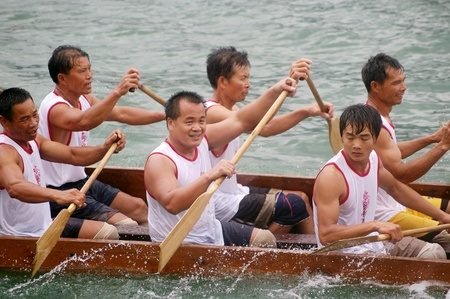 HONG KONG - JUN 16, Dragon boat race in Tung Ng Festival in Tuen Mun, Hong Kong on 16 June, 2010. It is a traditional festival in Chinese community. Stock Photo - 12935808
