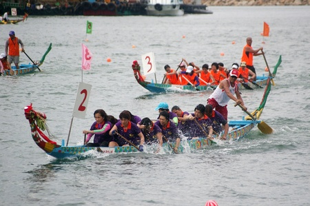 HONG KONG - JUN 16, Dragon boat race in Tung Ng Festival in Tuen Mun, Hong Kong on 16 June, 2010. It is a traditional festival in Chinese community. Stock Photo - 12935807