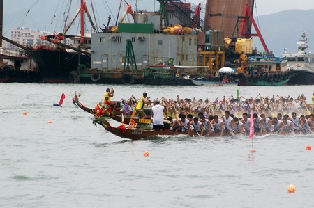 HONG KONG - JUN 16, Dragon boat race in Tung Ng Festival in Tuen Mun, Hong Kong on 16 June, 2010. It is a traditional festival in Chinese community. Stock Photo - 12935803