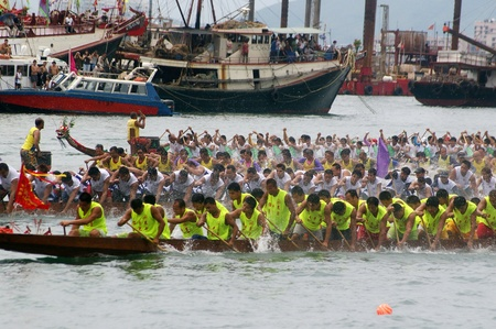 HONG KONG - JUN 16, Dragon boat race in Tung Ng Festival in Tuen Mun, Hong Kong on 16 June, 2010. It is a traditional festival in Chinese community. Stock Photo - 12935855