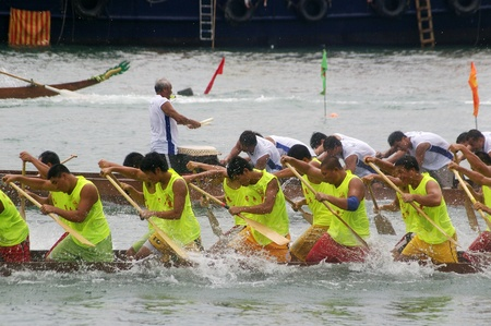 HONG KONG - JUN 16, Dragon boat race in Tung Ng Festival in Tuen Mun, Hong Kong on 16 June, 2010. It is a traditional festival in Chinese community. Stock Photo - 12935812