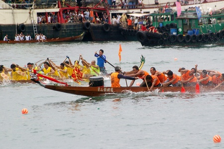 HONG KONG - JUN 16, Dragon boat race in Tung Ng Festival in Tuen Mun, Hong Kong on 16 June, 2010. It is a traditional festival in Chinese community. Stock Photo - 12935832
