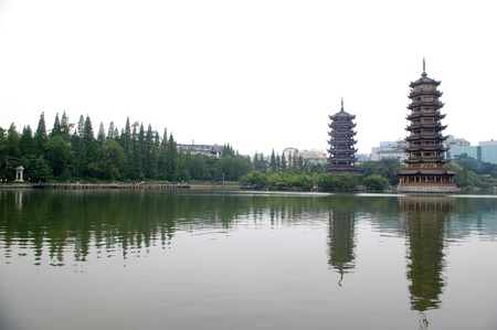 Golden tower and silver tower in the city of Guilin, China  photo