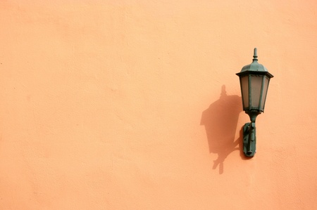 Orange lamp on wall photo