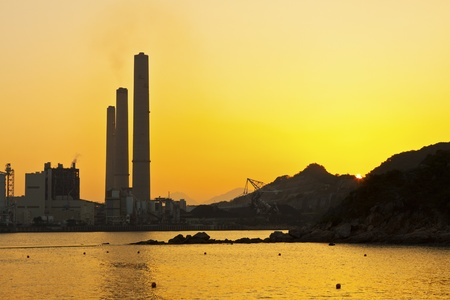 Power station along coast at sunset in Hong Kong