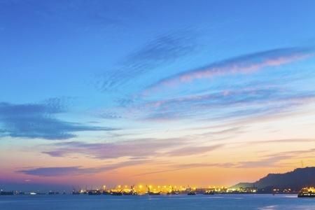 Sunset ocean with catgo ships  photo