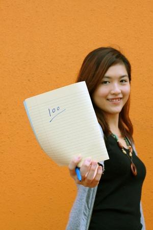 Asian university student showing full marks photo