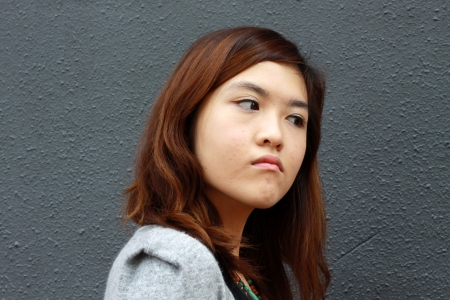 Asian woman with angry face photo