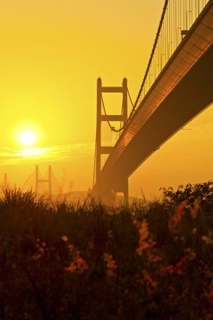 Tsing Ma Bridge in Hong Kong at sunset photo