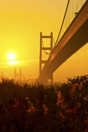 Tsing Ma Bridge in Hong Kong at sunset photo