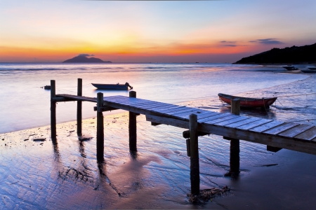 paradise bay: Sunset coast at wooden pier
