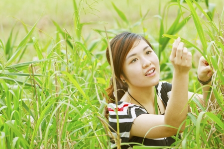Summer girl portrait. Asian woman smiling happy on sunny summer. photo