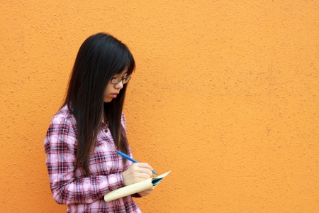 Asian woman reading and studying photo