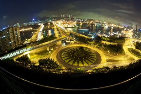 Hong Kong night traffic with modern buildings background photo