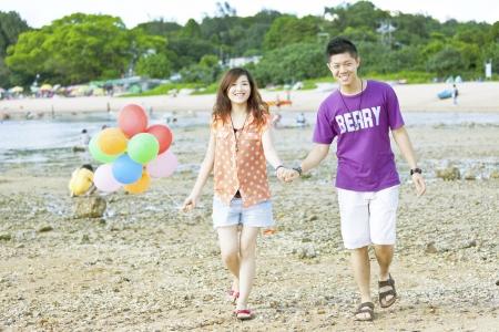 Happy asian couple at beach photo
