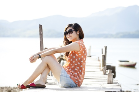 Asian woman on the wooden bridge photo